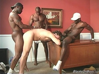 A black teacher and two black students sharing a white guy