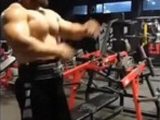 Shirtless Asian bodybuilder in the gym