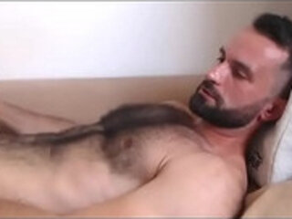 Hairy beauty jerks moans and cums