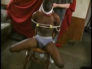 black slave tied to chair and pole